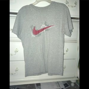 Boys Nike shirt with red swoosh